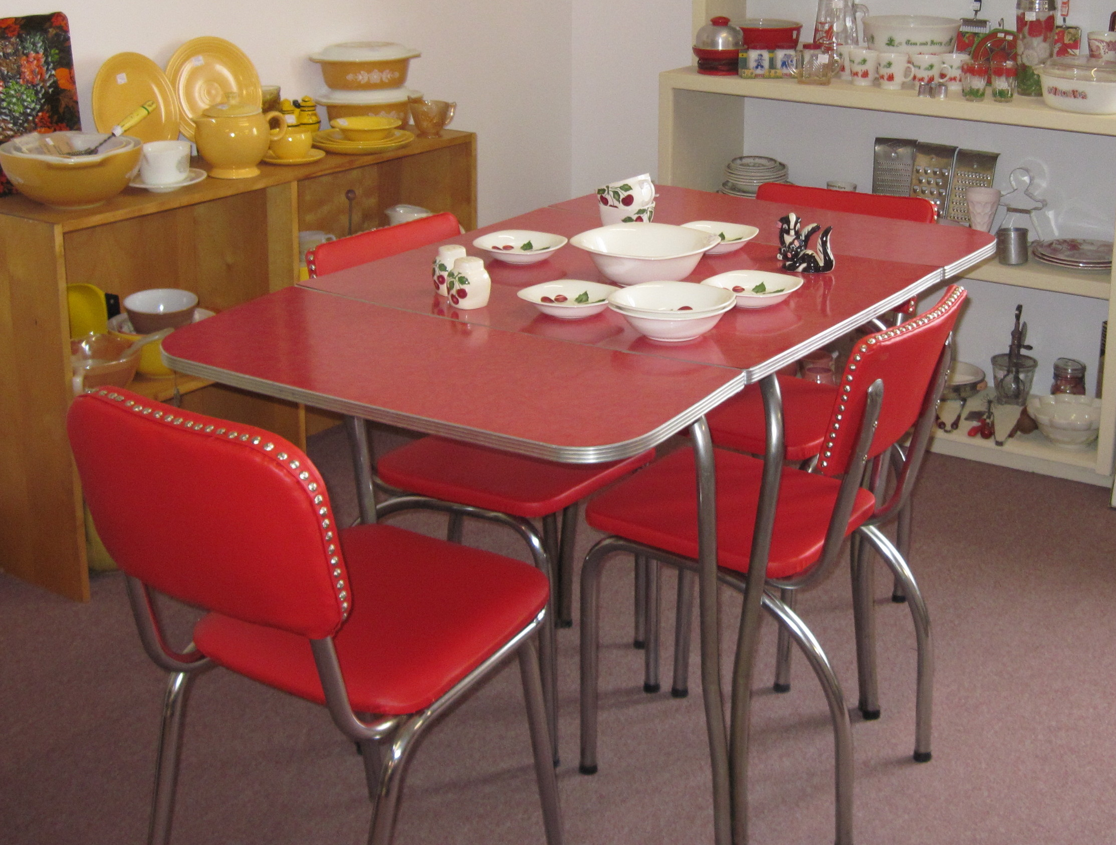 the fifties chairs were reupholstered in red marine vinyl the table